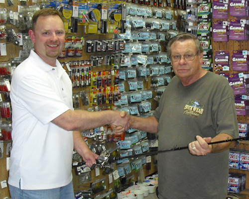 Larry Delozier winner of Zeiner's 58th Anniversary drawing of a Daiwa Zillion Rod & Reel combo